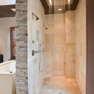 Example of a trendy travertine tile double shower design in DC Metro