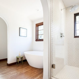 Mid-sized tuscan master white tile and ceramic tile medium tone wood floor bathroom photo in Sacramento with furniture-like cabinets, dark wood cabinets, a wall-mount toilet, white walls, an integrated sink and wood countertops