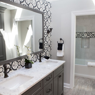 Bathroom - mid-sized transitional kids' multicolored tile and ceramic tile porcelain tile and multicolored floor bathroom idea in Chicago with recessed-panel cabinets, gray cabinets, a two-piece toilet, gray walls, an undermount sink, quartz countertops, a hinged shower door and multicolored countertops