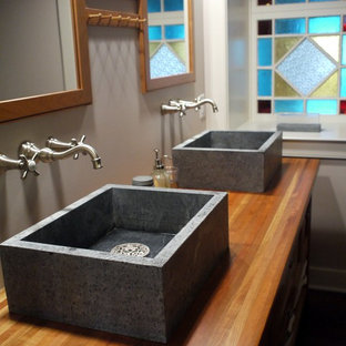 Example of a cottage bathroom design in Other with a vessel sink and wood countertops