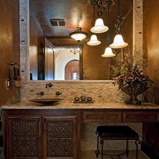 Bathroom - huge mediterranean master beige tile travertine floor bathroom idea in Austin with a vessel sink, furniture-like cabinets, dark wood cabinets, granite countertops and beige walls