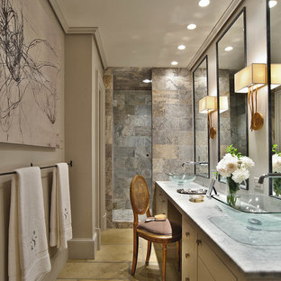 Small trendy master brown tile and stone tile concrete floor alcove shower photo in Charlotte with onyx countertops, a vessel sink, flat-panel cabinets, white cabinets, a two-piece toilet and gray walls