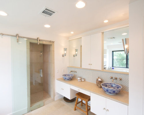 trendy bathroom photo in austin with a vessel sink flatpanel cabinets white
