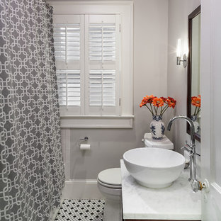 Inspiration for a timeless mosaic tile floor bathroom remodel in Atlanta with a vessel sink
