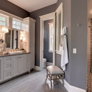 Inspiration for a timeless beige tile bathroom remodel in Minneapolis with a drop-in sink, shaker cabinets and white cabinets