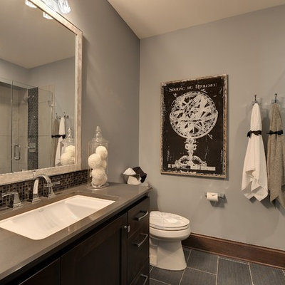 Inspiration for a timeless gray tile and mosaic tile alcove shower remodel in Minneapolis with an undermount sink, shaker cabinets and dark wood cabinets