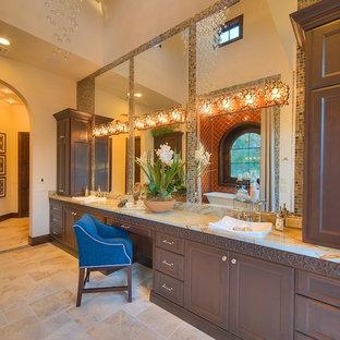 Imagen de cuarto de baño principal, mediterráneo, grande, con lavabo encastrado, armarios con paneles empotrados, puertas de armario marrones, bañera exenta, baldosas y/o azulejos naranja, baldosas y/o azulejos de cerámica, paredes beige, suelo de travertino, encimera de ónix y suelo beige
