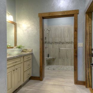 Huge tuscan 3/4 beige tile doorless shower photo in Denver with a vessel sink, furniture-like cabinets, distressed cabinets, granite countertops and gray walls