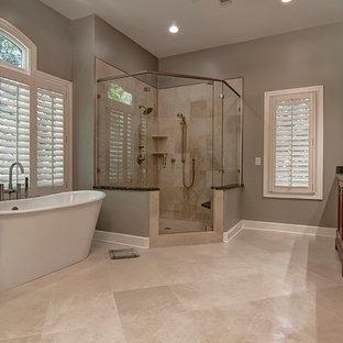 Bathroom - mediterranean master beige tile bathroom idea in Charleston with recessed-panel cabinets, medium tone wood cabinets and beige walls