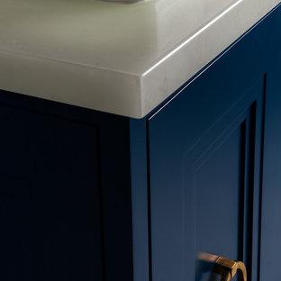 Immagine di una stanza da bagno padronale chic di medie dimensioni con lavabo a bacinella, consolle stile comò, ante blu, top in vetro, vasca ad angolo, doccia ad angolo, piastrelle bianche, piastrelle in pietra, pareti grigie e pavimento in marmo