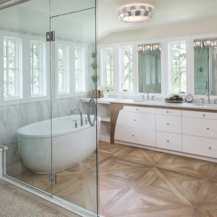 Bathroom - large transitional master gray tile, white tile and stone tile dark wood floor bathroom idea in Minneapolis with flat-panel cabinets, white cabinets, gray walls, an undermount sink and marble countertops