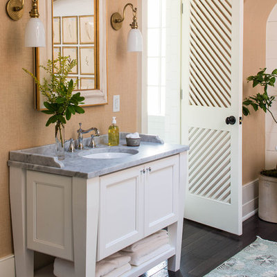 Inspiration for a mid-sized timeless 3/4 white tile and subway tile dark wood floor and brown floor bathroom remodel in Birmingham with white cabinets, recessed-panel cabinets, an undermount sink, marble countertops and beige walls