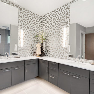 Bathroom - large contemporary master gray tile, multicolored tile, white tile and mosaic tile white floor bathroom idea in Seattle with flat-panel cabinets, gray cabinets, an undermount sink, quartz countertops and multicolored walls