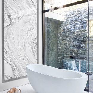 Large trendy master white tile and marble tile white floor and marble floor freestanding bathtub photo in Atlanta