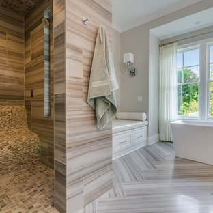 Example of a large transitional master brown tile and porcelain tile porcelain tile and beige floor bathroom design in Cleveland with beaded inset cabinets, beige cabinets, a two-piece toilet, beige walls, an undermount sink, marble countertops, a hinged shower door and white countertops