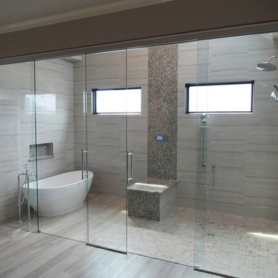 Bathroom - large contemporary master gray tile and porcelain tile light wood floor and gray floor bathroom idea in Chicago with gray walls