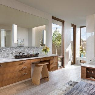 На фото: огромная главная ванная комната в современном стиле с плоскими фасадами, фасадами цвета дерева среднего тона, накладной ванной, серой плиткой, плиткой мозаикой, врезной раковиной, серым полом, душем без бортиков, унитазом-моноблоком, белыми стенами, полом из керамогранита, столешницей из искусственного камня и душем с распашными дверями с