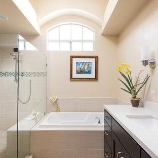 Large tuscan master beige tile and porcelain tile bathroom photo in San Diego with dark wood cabinets, beige walls, an undermount sink, engineered quartz countertops and a hinged shower door