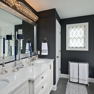 Inspiration for a beach style ensuite bathroom in Boston with recessed-panel cabinets, white cabinets, multi-coloured tiles, white tiles, black walls, a submerged sink, grey floors and a hinged door.