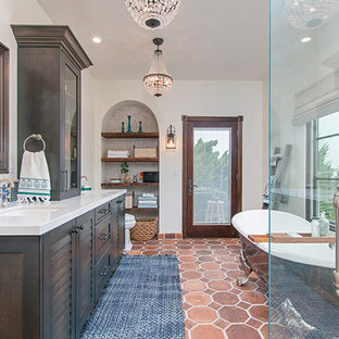Inspiration for a large mediterranean ensuite bathroom in San Diego with louvered cabinets, dark wood cabinets, a claw-foot bath, a corner shower, a one-piece toilet, white tiles, mosaic tiles, white walls, porcelain flooring, a submerged sink, multi-coloured floors, a hinged door and white worktops.