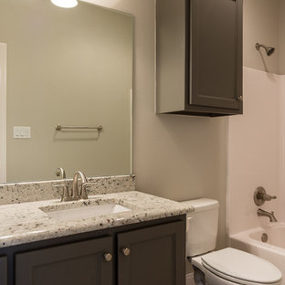Traditional family bathroom in Austin with a submerged sink, shaker cabinets, green cabinets, granite worktops, an alcove bath, a shower/bath combination, grey walls and porcelain flooring.