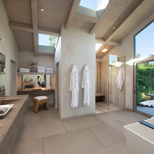 Expansive contemporary ensuite bathroom in Santa Barbara with flat-panel cabinets, grey cabinets, a freestanding bath, a walk-in shower, grey walls, an integrated sink, porcelain flooring, engineered stone worktops and an open shower.