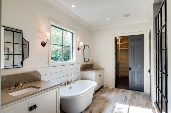 Farmhouse Bathroom by Chandelier Development Inc