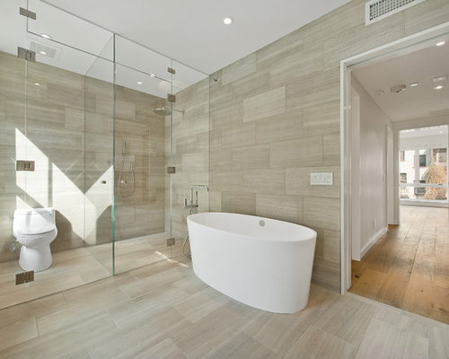 Example Of A Trendy Beige Tile Bathroom Design In New York