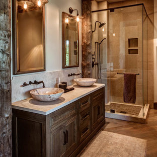 Bathroom - mid-sized rustic 3/4 gray tile bathroom idea in Salt Lake City with medium tone wood cabinets, a vessel sink and beige walls