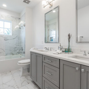 Inspiration for a large transitional 3/4 gray tile, white tile and porcelain tile porcelain tile, gray floor and double-sink bathroom remodel in DC Metro with shaker cabinets, gray cabinets, a two-piece toilet, white walls, an undermount sink, white countertops and a built-in vanity