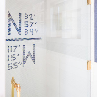 Inspiration for a transitional pebble tile alcove shower remodel in San Diego with louvered cabinets, white cabinets, blue walls, marble countertops and a hinged shower door