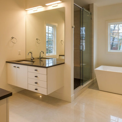 Bathroom - large modern master white tile marble floor and beige floor bathroom idea in DC Metro with flat-panel cabinets, white cabinets, a two-piece toilet, white walls, an undermount sink, quartz countertops and gray countertops