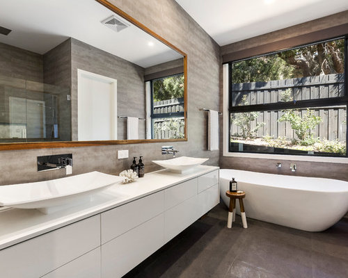 Contemporary Master Bathroom In Melbourne With Flat Panel Cabinets, White  Cabinets, A Freestanding