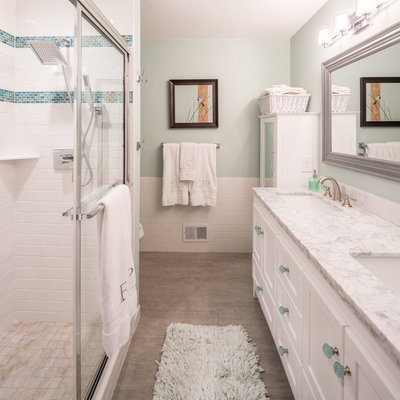 Mid-sized transitional master gray tile and ceramic tile ceramic tile and beige floor bathroom photo in Minneapolis with furniture-like cabinets, white cabinets, green walls, an integrated sink, a one-piece toilet and marble countertops