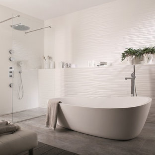 Trendy white tile and ceramic tile porcelain floor bathroom photo in Perth with white walls