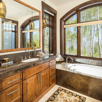 Bathroom - huge rustic brown tile and mosaic tile beige floor bathroom idea in Salt Lake City with marble countertops, recessed-panel cabinets, medium tone wood cabinets, an undermount tub, white walls, an undermount sink and brown countertops