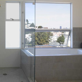 Bathroom - modern subway tile bathroom idea in San Francisco with white walls and a hinged shower door