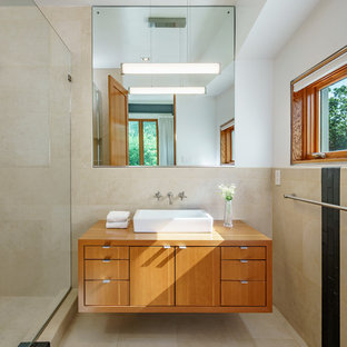 Example of a small urban 3/4 beige tile and porcelain tile porcelain floor and multicolored floor bathroom design in DC Metro with medium tone wood cabinets, white walls, a vessel sink and wood countertops