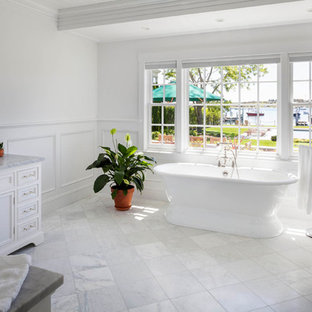 Bathroom - large traditional master white tile bathroom idea in Boston with an undermount sink, beaded inset cabinets, white cabinets, marble countertops and white walls