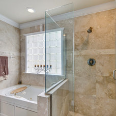 Tropical Bathroom by Emerald Coast Real Estate Photography