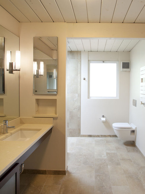 midcentury modern bathroom photo in san francisco with a wallmount toilet