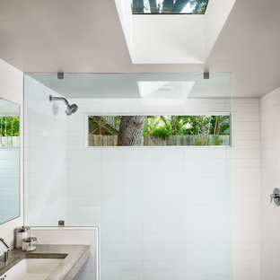 Inspiration for a contemporary concrete floor bathroom remodel in Austin with concrete countertops