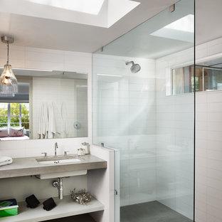 Inspiration för ett funkis badrum, med bänkskiva i betong och betonggolv