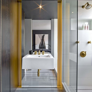 Inspiration for a contemporary white tile gray floor alcove shower remodel in New York with a wall-mount sink