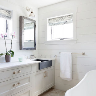 Mid-sized country master beige floor, single-sink and shiplap wall freestanding bathtub photo in Boston with shaker cabinets, gray cabinets, white walls, an undermount sink, white countertops and a built-in vanity