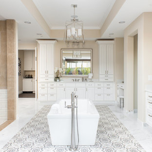 Example of a tuscan master cement tile floor and multicolored floor bathroom design in Phoenix with raised-panel cabinets, white cabinets, beige walls and an undermount sink