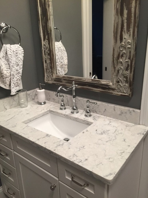 Rustic Bathroom Idea In Other With An Undermount Sink, White Cabinets,  Engineered Quartz Countertops
