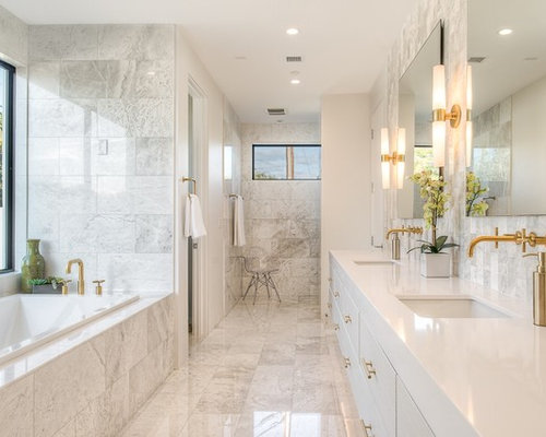 example of a mid sized trendy master stone tile and white tile marble floor bathroom