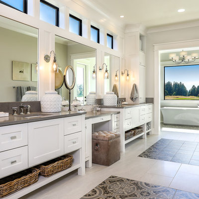 Bathroom - large farmhouse master ceramic tile and multicolored floor bathroom idea in Portland with shaker cabinets, white cabinets, gray walls, an undermount sink, a two-piece toilet, quartz countertops, a hinged shower door and white countertops