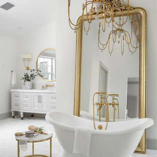 Large cottage master light wood floor freestanding bathtub photo in Phoenix with white cabinets, a bidet, an undermount sink, marble countertops, a hinged shower door, white countertops and recessed-panel cabinets